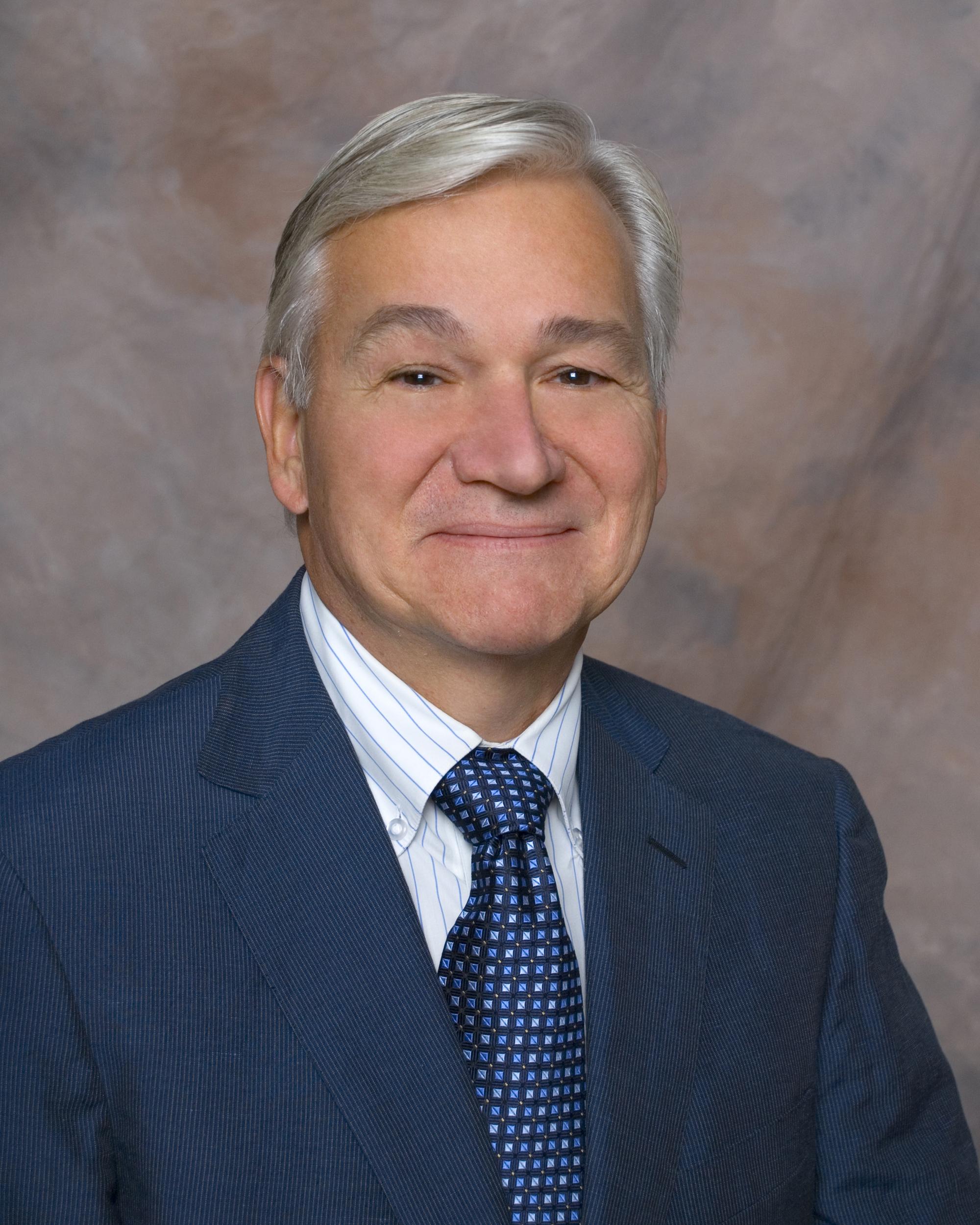 Dr. Leighton Johnson
