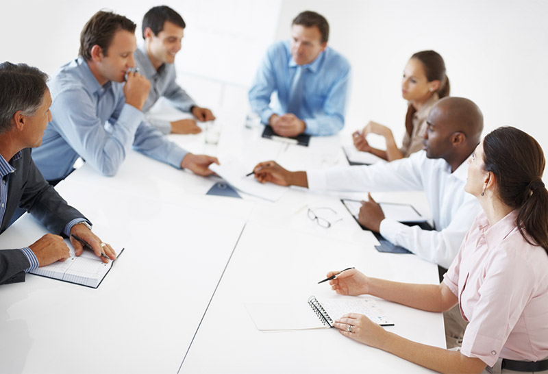 discussing health care change in a board room