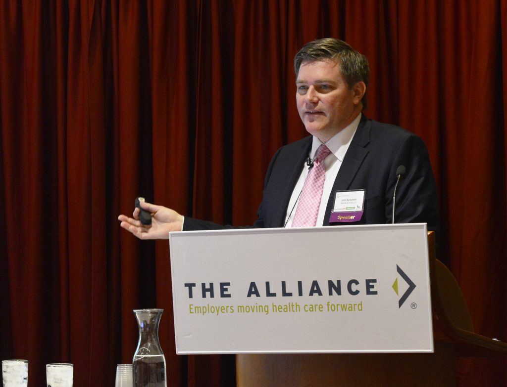 John Barlament speaking on health policy at an event by The Alliance