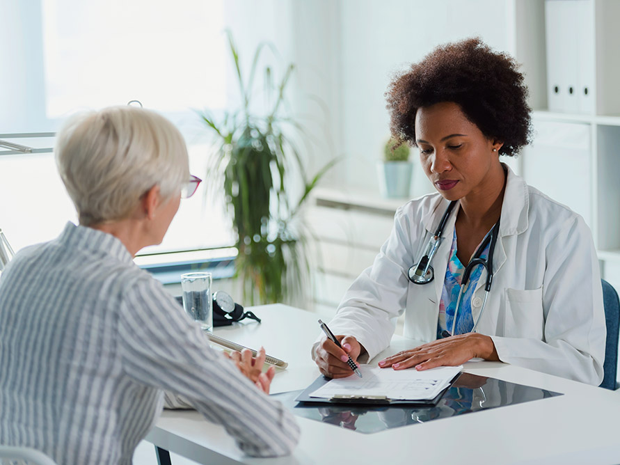 Doctor with older patient