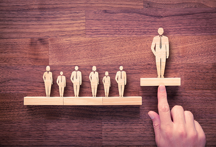 Leadership graphic with wooden people