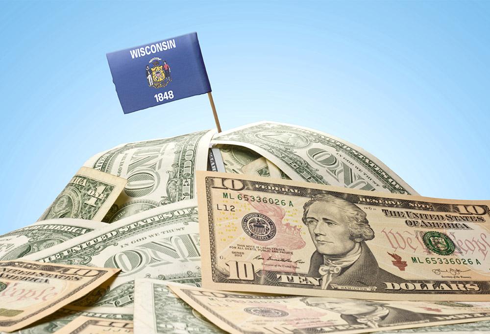 Wisconsin flag on pile of money