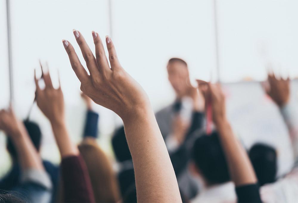 Hands raised at presentation