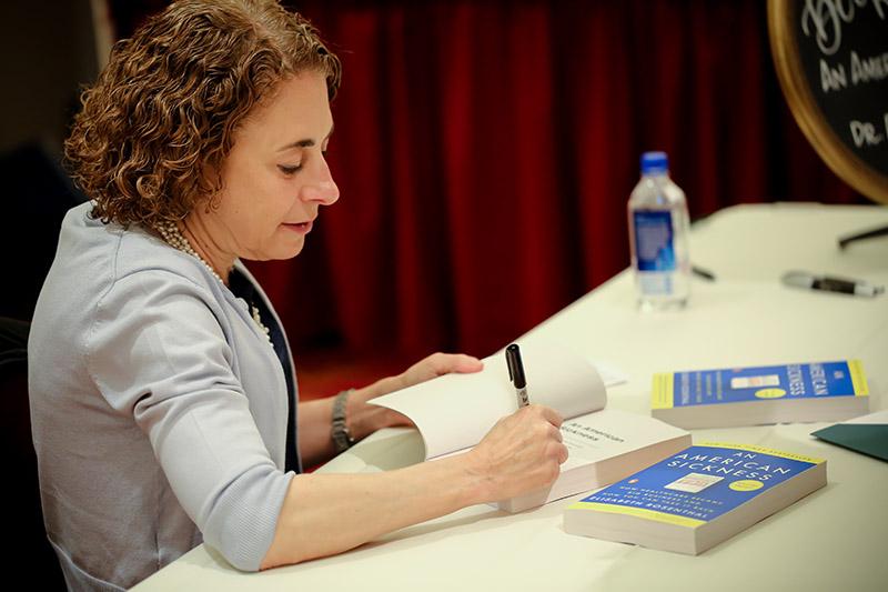 Elisabeth Rosenthal signing a book