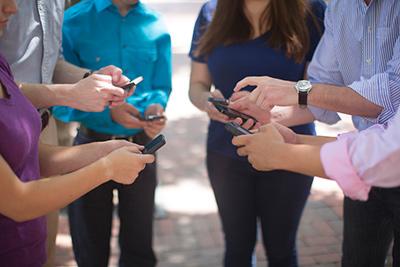 millenials looking at phones